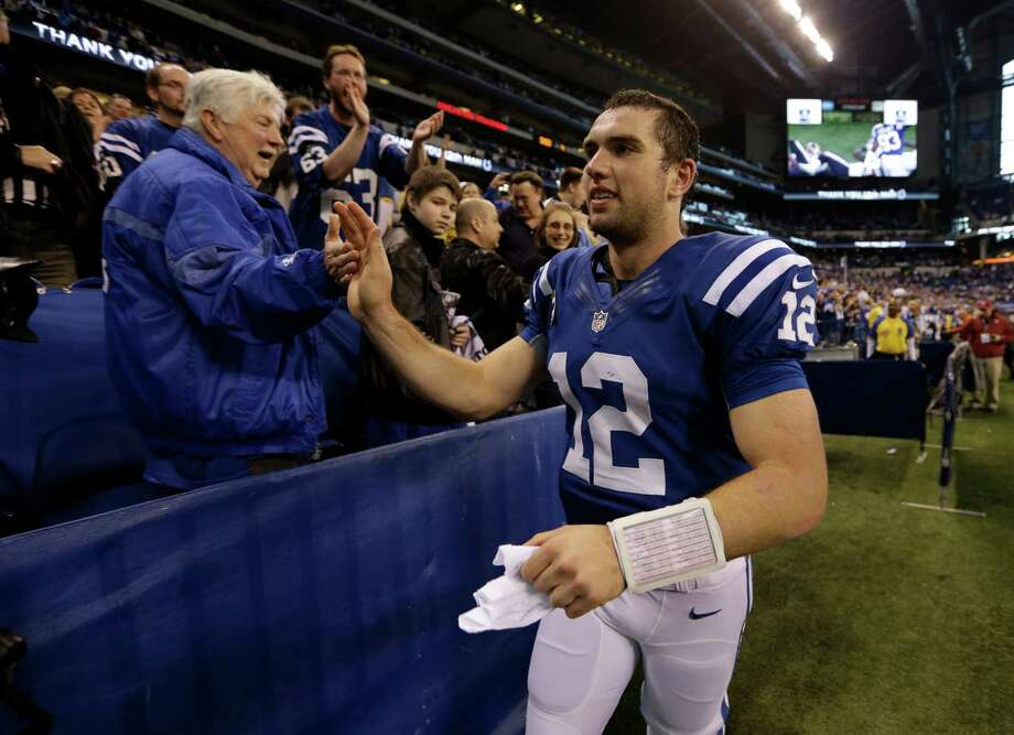 Indianapolis Colts' Andrew Luck (12) greets fans after the Colts defeated the Houston Texans, 28-16, in an NFL football game Sunday, Dec. 30, 2012, in Indianapolis. (AP Photo/Michael Conroy) Photo: Michael Conroy, Associated Press / AP