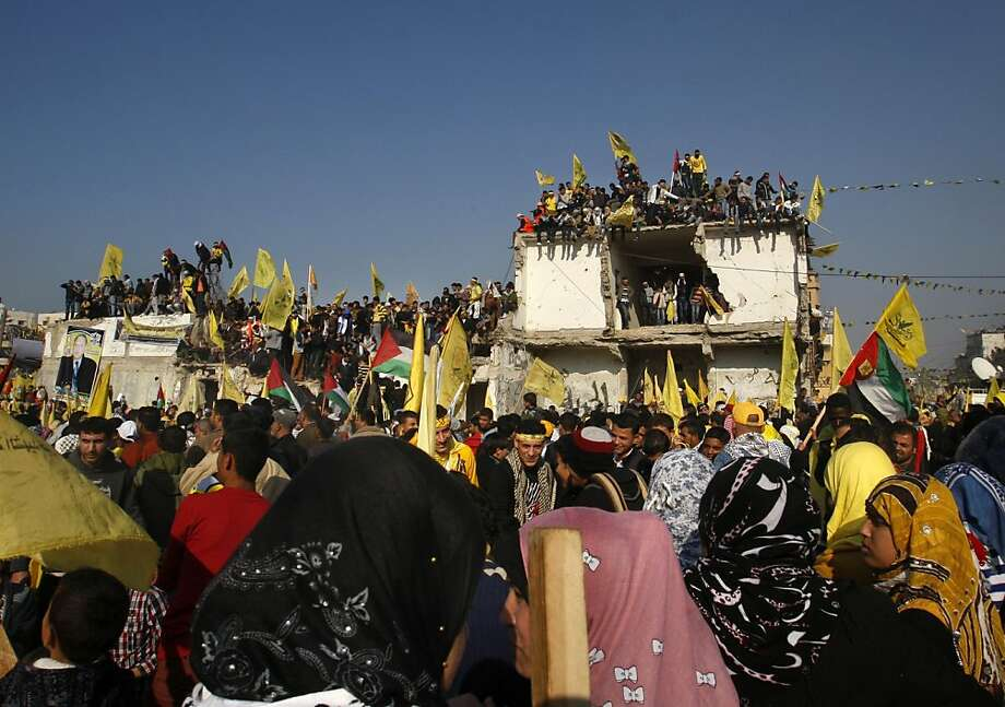 Palestinians wave yellow Fatah flags during celebrations marking the 48th anniversary of the Fatah movement in Gaza City, Friday, Jan. 4, 2013. The secular-leaning Fatah party staged a massive rally Friday in the Gaza Strip, the first such gathering in the territory since the Islamist Hamas group violently took control there in 2007 - a reflection of the warming ties between the two rival Palestinian factions. Photo: Hatem Moussa, Associated Press