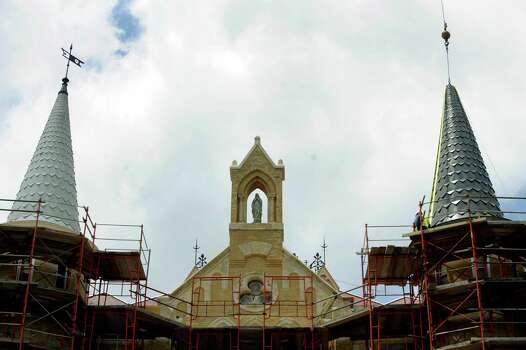 The new spire, right, closely matches one that was constructed in 1895, left, atop the Main Building of Our Lady of the Lake University on April 21, 2010. A fire on May 6, 2008, destroyed the old one and much of interior of the building. BILLY CALZADA / gcalzada@express-news.net Photo: BILLY CALZADA, Express-News / gcalzada@express-news.net