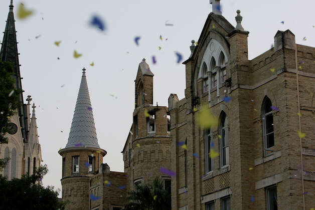 "Confetti flies over the Our Lady of the Lake University commemoration of the one-year-anniversary of the fire that damaged the main building ""Building Dreams"" event, Wednesday, May 6, 2009. JERRY LARA/glara@express-news.net Photo: JERRY LARA, Express-News / glara@express-news.net"