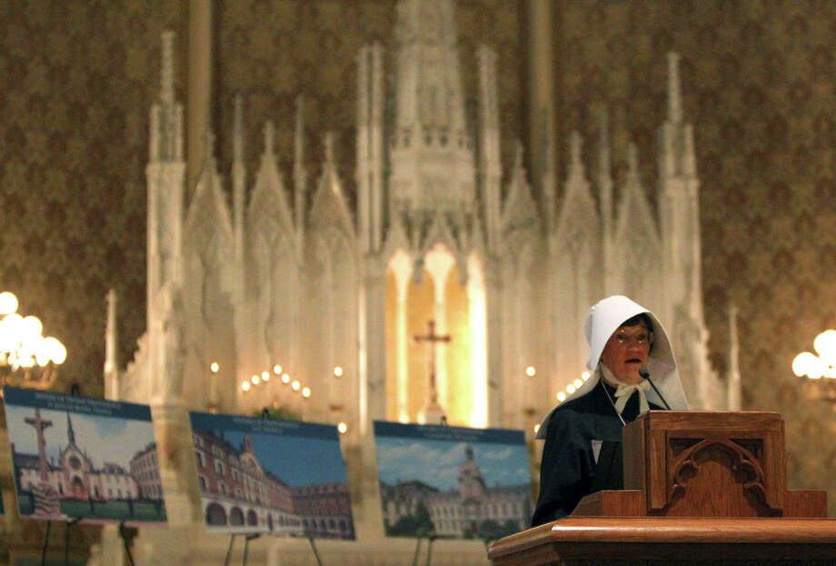 Sister Theresa Gossen (at lectern) tells some of the story of the Sisters of Divine Providence and the Missionary Catechists of Divine Providence and the 250th anniversary celebration of the groups. The celebration was held at Sacred Heart Conventual Chapel at Our Lady of the Lake University, Jan. 15, 2012) JOHN DAVENPORT/jdavenport@express-news.net Photo: JOHN DAVENPORT, Express-News / SAN ANTONIO EXPRESS-NEWS (Photo can be sold to the public)