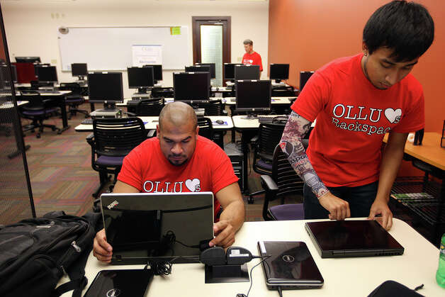 Computer Information Systems and Security program students Roy Delgado, 34, left, and Roberto Hernandez, 20, work in the Rackspace Smart Classroom at Our Lady of the Lake University, Sept. 21, 2011. The room was opened with donations from Rackspace Hosting who also donated $150,000 to the university. JERRY LARA/glara@express-news.net Photo: JERRY LARA, Express-News / SAN ANTONIO EXPRESS-NEWS