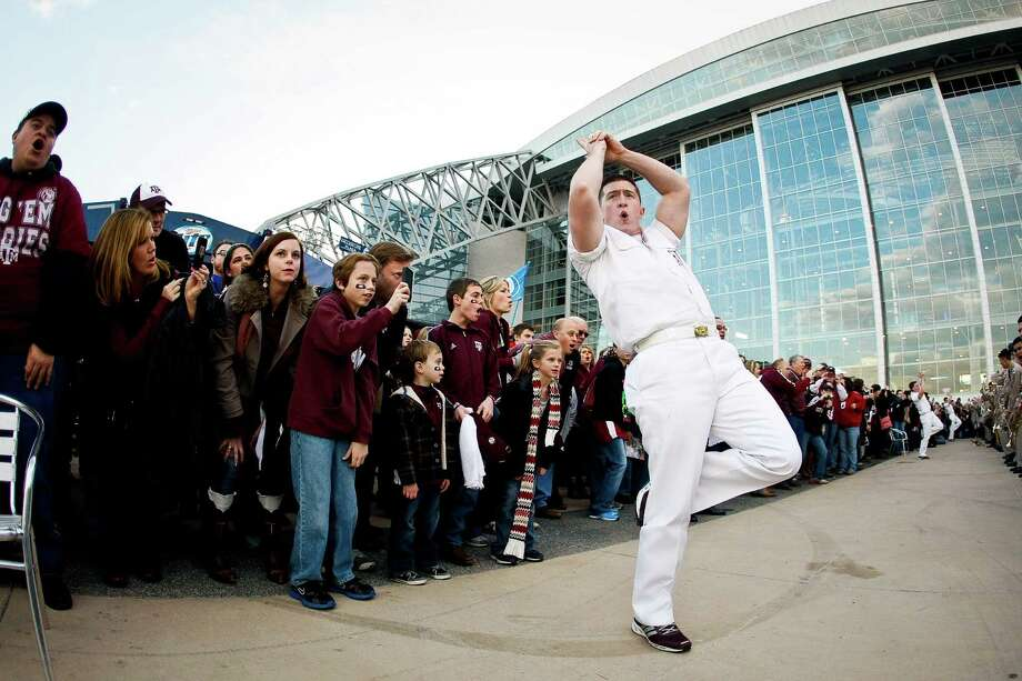 Nelson Ingram, a Texas A&M yell leader from Tuscola, Texas, performs during a pep rally outside  Cowboys Stadium before Texas A&M plays Oklahoma in the Cotton Bowl football game, Friday, Jan. 4, 2013, in Arlington. Photo: Nick De La Torre, Houston Chronicle / © 2013  Houston Chronicle