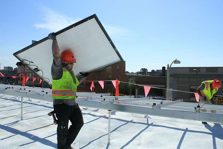 A Sun Light & Power worker at the partially crowdfunded Oakland Youth Employment Partnership project. Photo: Courtesy Mosaic