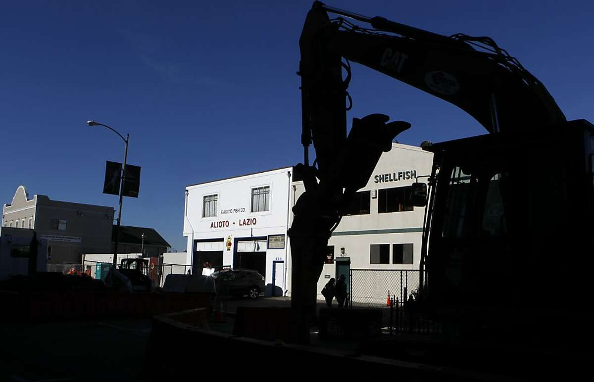 Construction equipment is parked in front of the Alioto-Lazio Fish Company in San Francisco, Calif. on Friday, Jan. 4, 2013. The owners of the family-run business are upset by a contractor's handling of the major road project on Jefferson Street.