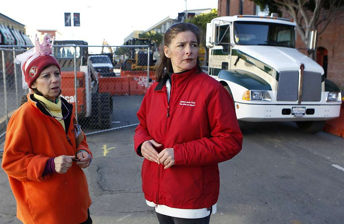 Annette Traverso (left) and her sister Angela Cincotta view the construction work in front of their seafood business, Alioto-Lazio Fish Company, in San Francisco, Calif. on Friday, Jan. 4, 2013. The co-owners are upset by a contractor's handling of a major road project on Jefferson Street.