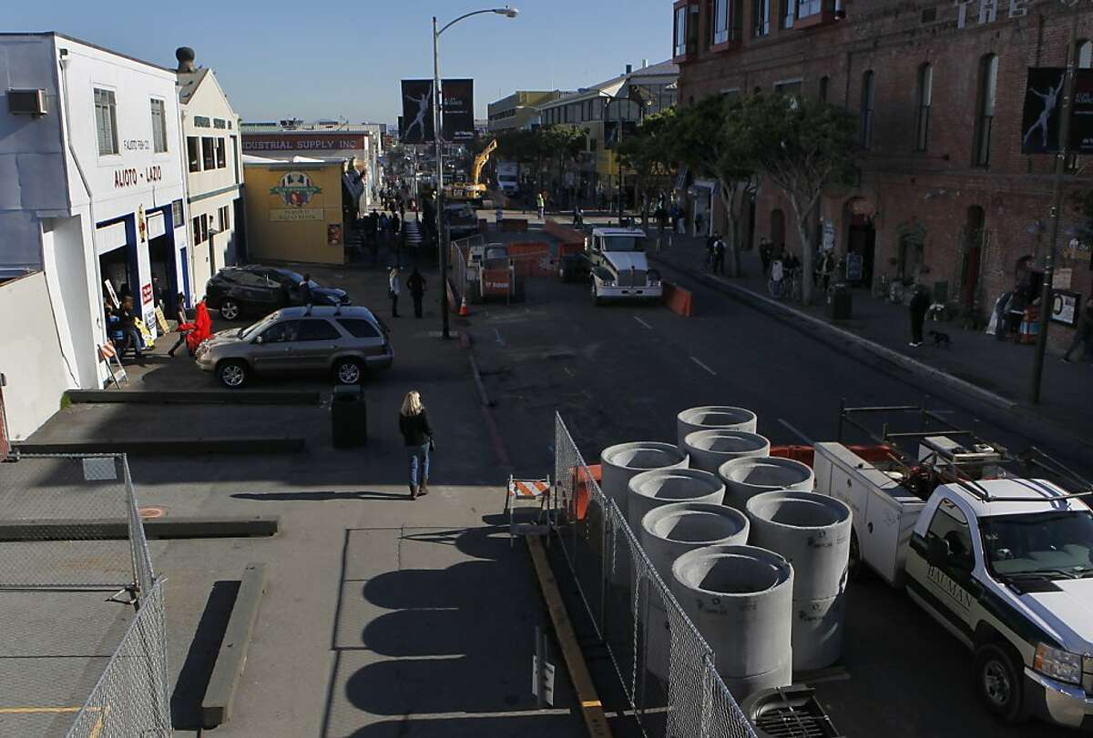 A road construction project is underway in front of the Alioto-Lazio Fish Company (left) in San Francisco, Calif. on Friday, Jan. 4, 2013. The owners of the seafood business are upset by a contractor's handling of the project on Jefferson Street.
