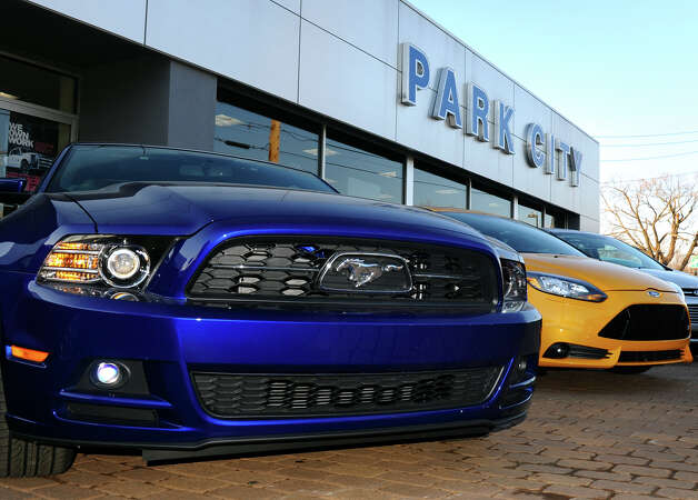 A new Mustang sits on the lot with other new vehicles for sale at Park City Ford in Bridgeport, Conn. on Friday January 4, 2013. American care sales overall in 2012 have seen the best increase in five years. Photo: Christian Abraham / Connecticut Post