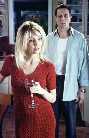 "No '90s gallery would be complete without Heather Locklear as Amanda in ""Melrose Place."" She's pictured with Rob Estes.  Photo: GREGORY SCHWARTZ, FOX  / FOX BROADCASTING COMPANY"