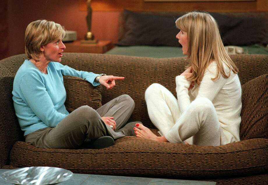 "Ellen DeGeneres (left) came out as a lesbian on ""The Oprah Winfrey Show"" in 1997, a big moment followed by her character's coming out in the sitcom ""Ellen."" Some affiliates refused to air the episode, which starred Laura Dern (right), saying it was ""inappropriate"" for family viewing.  Photo: MIKE ANSELL, Associated Press / TOUCHSTONE TELEVISION"