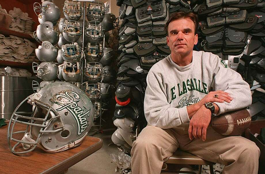 Bob Ladouceur sits in the equipment room for a portrait around the time he established the nation's longest win streak. Photo: Sam Morris, SM