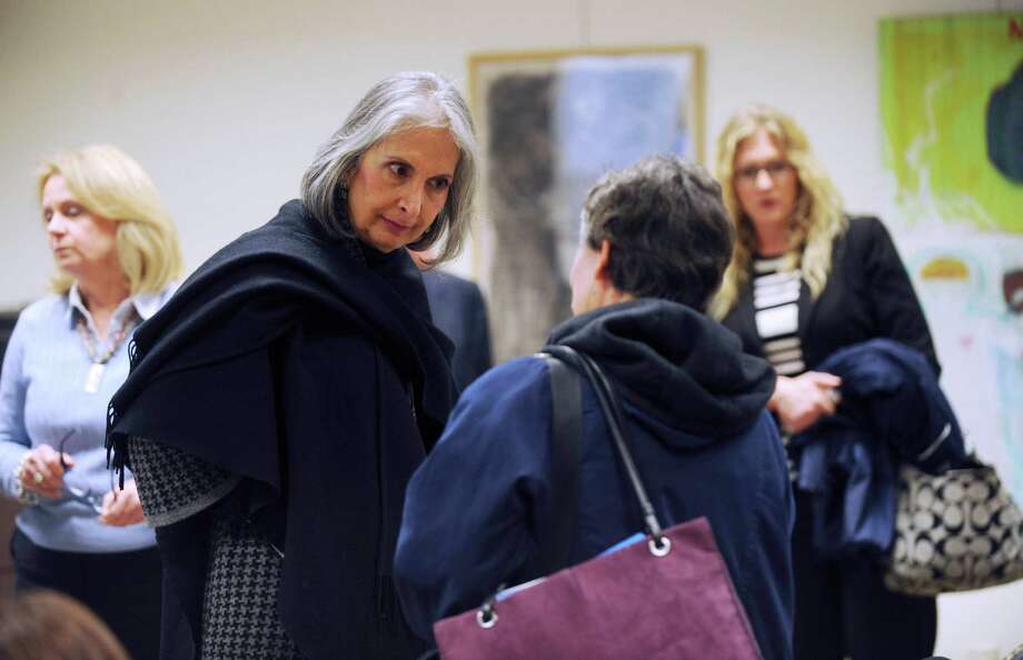 President Tessa Martinez Pollack, middle, speaks with people attending a meeting during which Our Lady of the Lake University's new strategic plans were discussed on Friday, Jan. 4, 2013. Photo: Billy Calzada, San Antonio Express-News / SAN ANTONIO EXPRESS-NEWS