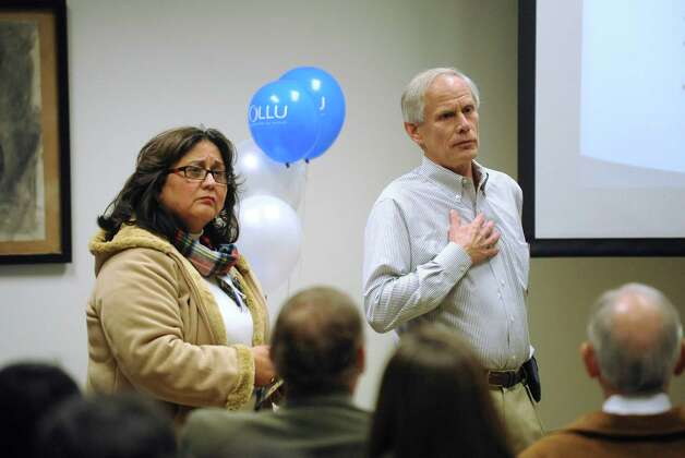 Chief technology officer Joe Deck and Vice President for Mission and Ministry Gloria Urrabazo speak  during a meeting in which Our Lady of the Lake University's new strategic plans were discussed on Friday, Jan. 4, 2013. Photo: Billy Calzada, San Antonio Express-News / SAN ANTONIO EXPRESS-NEWS
