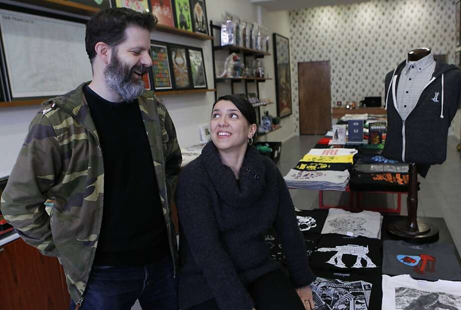 Brian Flynn and wife Dora Drimalas, both self-employed, have refinanced twice in six months. Photo: Paul Chinn, The Chronicle
