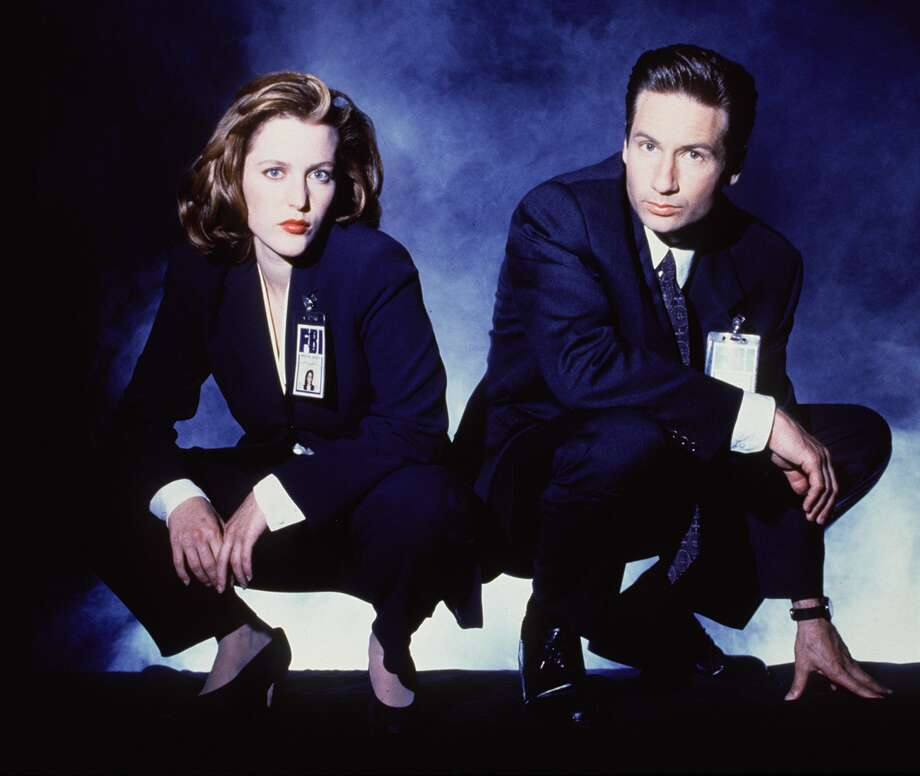 Special Agent Dana Scully, played by Gillian Anderson (left), is a medical doctor who investigates the paranormal on 'The X-files.'   Photo: File, File