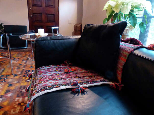 A camel from Turkey adorns a couch in this Grant Avenue home. Photo: Billy Calzada, San Antonio Express-News / SAN ANTONIO EXPRESS-NEWS