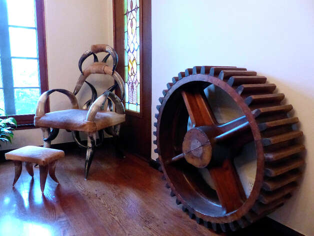 A wooden cog and Western-style chair in this home on Grant Avenue in Alamo Heights. Photo: Billy Calzada, San Antonio Express-News / SAN ANTONIO EXPRESS-NEWS