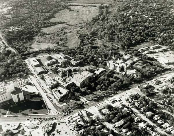 The University of the Incarnate Word Campus is seen in this undated 1979 aerial photo. The intersection of Broadway and Hildebrand is seen at the bottom of the frame with Hildebrand going up and to the left and Broadway going out to the right. Earl Abel's restaurant can be seen near the intersection at the bottom of the frame. Olmos Dam can just barely be seen at the top of the frame above the broad swatch of grass. Photo: COURTESY PHOTO FROM UIW, Express-News / COURTESY PHOTO FROM UIW
