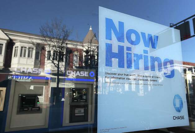 "A ""now hiring"" sign is posted in the window of a Chase bank branch on January 4, 2013 in San Rafael, California. According to a Labor Department December jobs report, the U.S. unemployment remained the same from November at 7.8% as employers added 155,000 jobs in December.  (Photo by Justin Sullivan/Getty Images) Photo: Justin Sullivan, Getty Images / 2013 Getty Images"
