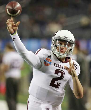 Texas A&M quarterback Johnny Manziel warms up before the Cotton Bowl NCAA college football game against Oklahoma at Cowboys Stadium on Friday, Jan. 4, 2013, in Irving, Texas. (AP Photo/LM Otero) Photo: LM Otero, Associated Press / AP