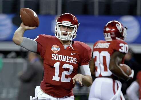 Oklahoma's Landry Jones (12) warms up for the Cotton Bowl NCAA college football game against Texas A&M, Friday, Jan. 4, 2013, in Arlington, Texas. (AP Photo/Tony Gutierrez) Photo: Tony Gutierrez, Associated Press / AP