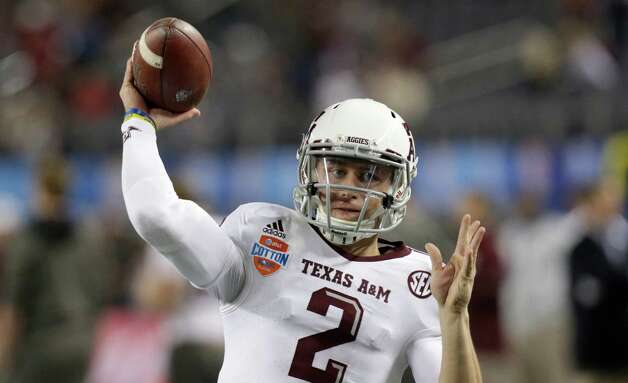 Texas A&M quarterback Johnny Manziel warms up before the Cotton Bowl NCAA college football game against Oklahoma at Cowboys Stadium Friday, Jan. 4, 2013, in Irving, Texas. (AP Photo/LM Otero) Photo: LM Otero, Associated Press / AP