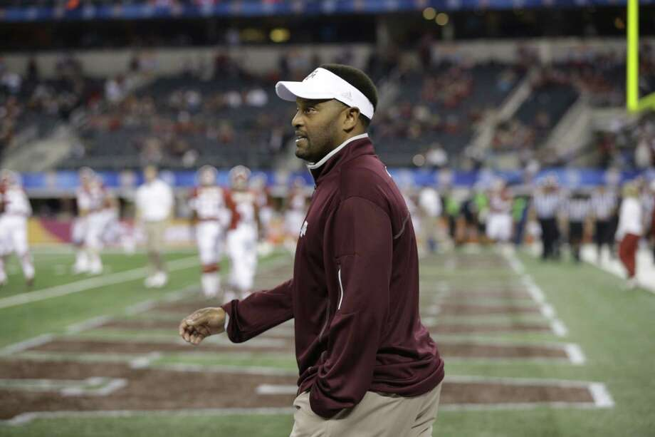 Texas A&M head coach Kevin Sumlin walks onto the field before the Cotton Bowl NCAA college football game against Oklahoma Friday, Jan. 4, 2013, in Arlington, Texas. (AP Photo/Tony Gutierrez) Photo: Tony Gutierrez, Associated Press / AP