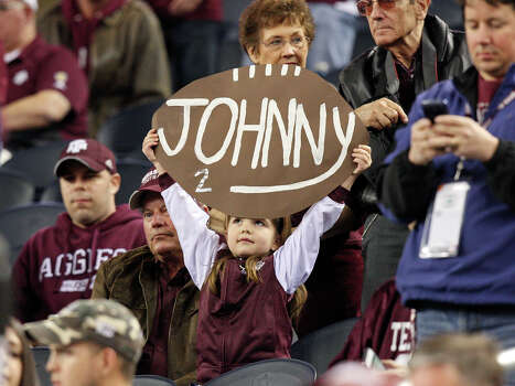 A Texas A&M Aggies fan holds a sign before the 77th AT&T Cotton Bowl Classic with the Oklahoma Sooners Friday Jan. 4, 2013 at Cowboys Stadium in Arlington, Tx. Photo: Edward A. Ornelas, Express-News / © 2012 San Antonio Express-News