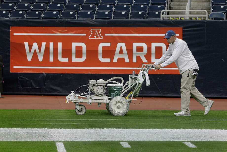 Grounds crew member Andy Hollister moves a painting machine as crew paints the NFL football field at Reliant Stadium Friday, Jan. 4, 2013, in Houston. Photo: Melissa Phillip, Houston Chronicle / © 2012 Houston Chronicle