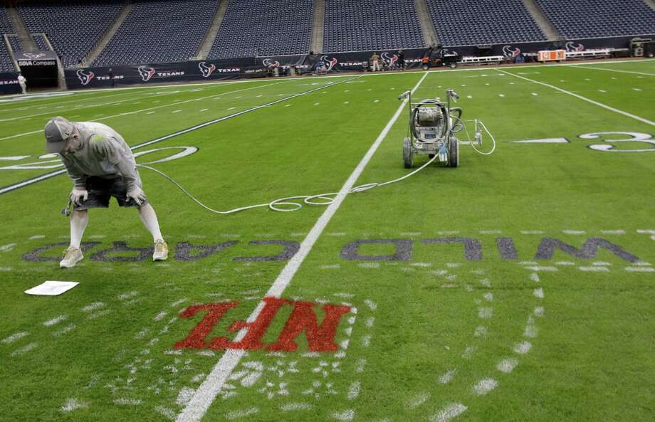 It takes 8 to 10 hours to complete the paint job on the entire field, using 150 gallons of water based paint. Photo: Melissa Phillip, Houston Chronicle / © 2012 Houston Chronicle