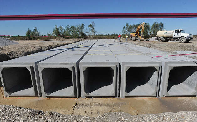 Drainage lines are being installed under the upcoming OmniPort's rail lines that are expected to be online by the first quarter of 2012.  Photo taken Thursday, November 10, 2010 Guiseppe Barranco/The Enterprise Photo: Guiseppe Barranco, STAFF PHOTOGRAPHER / The Beaumont Enterprise