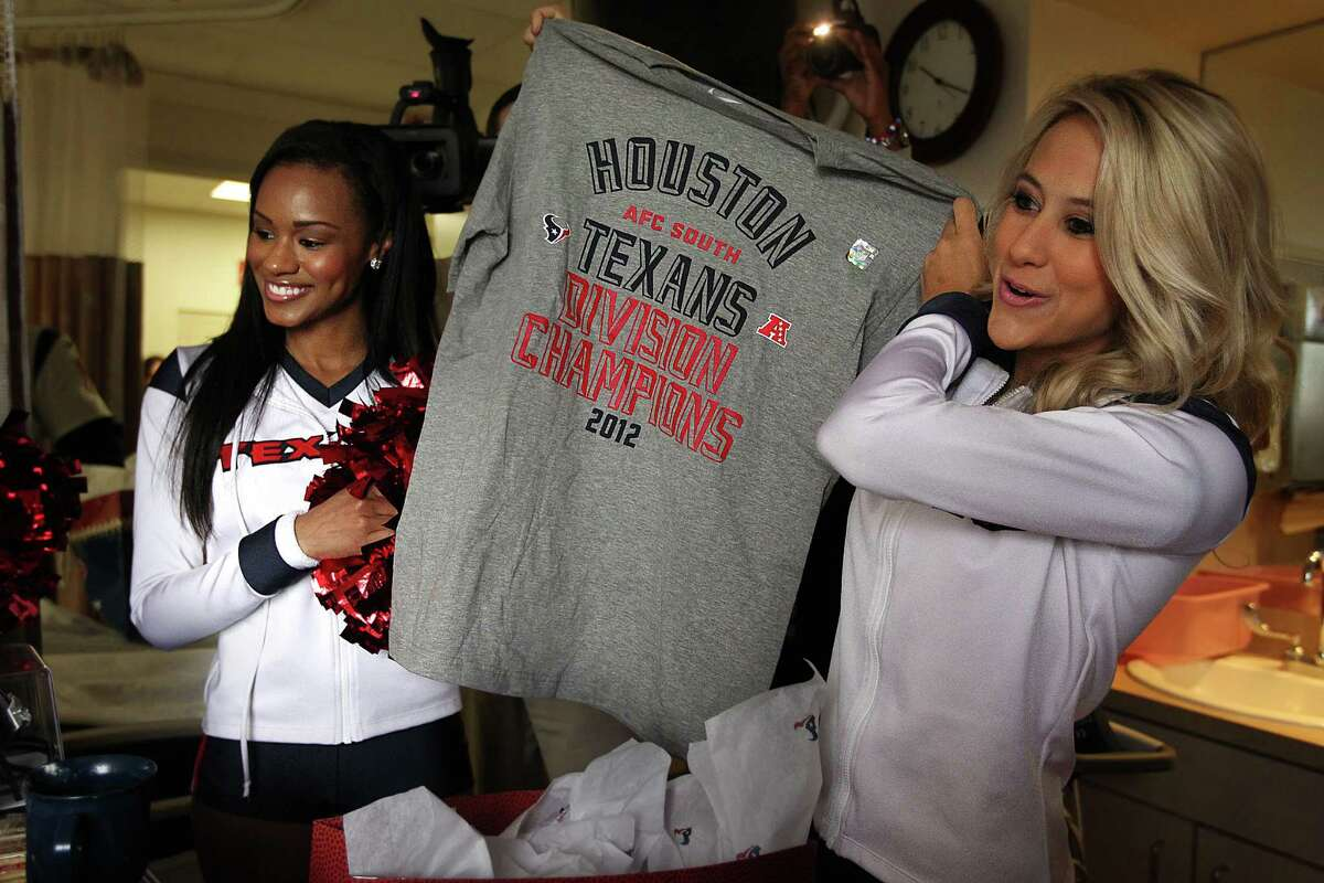 Texans cheerleaders Brittany, left, and Lauren L. show patients a gift from the Texans during a visit at Methodist Outpatient Center on Thursday. Lauren L. was voted the NFL's most beautiful cheerleader.