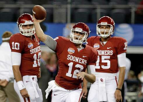 Oklahoma Sooners quarterback Blake Bell (10) and Drew Allen (15) watch as starting quarterback Landry Jones passes before the Cotton Bowl NCAA college football game against Texas A&M Friday, Jan. 4, 2013, in Arlington, Texas. (AP Photo/Tony Gutierrez) Photo: Tony Gutierrez, Associated Press / AP