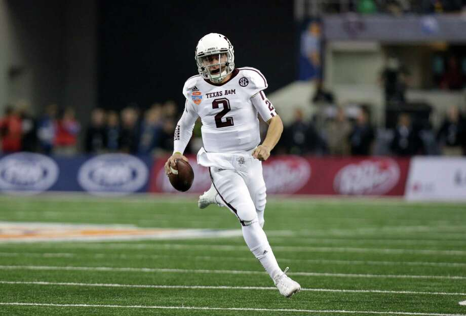 Texas A&M's Johnny Manziel (2) finds running room against Oklahoma on his way to the end zone for a score in the first half of the Cotton Bowl NCAA college football game Friday, Jan. 4, 2013, in Arlington, Texas. (AP Photo/LM Otero) Photo: LM Otero, Associated Press / AP