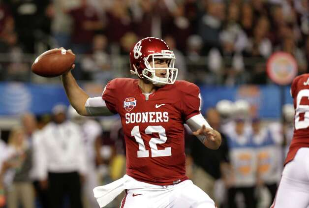 Oklahoma Sooners quarterback Landry Jones (12) passes in the first half of the Cotton Bowl NCAA college football game against Texas A&M Friday, Jan. 4, 2013, in Arlington, Texas. (AP Photo/LM Otero) Photo: LM Otero, Associated Press / AP