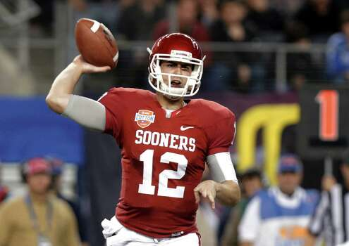 Oklahoma quarterback Landry Jones passes against Texas A&M during the first half of the Cotton Bowl NCAA college football game Friday, Jan. 4, 2013, in Arlington, Texas. (AP Photo/LM Otero) Photo: LM Otero, Associated Press / AP