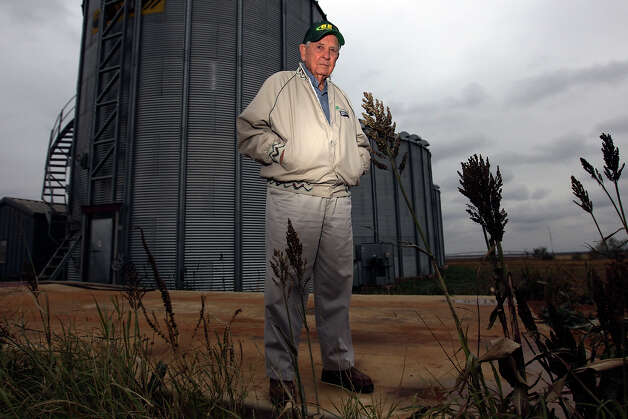 Farmer Jack Chiodo stands near his grain silos near Dilley. Chiodo, a 1939 graduate of Brackenridge High School and a retired military pilot, began farming in 1965 and aims to keep his farm in the family. Photo: Kin Man Hui, San Antonio Express-News / © 2012 San Antonio Express-News
