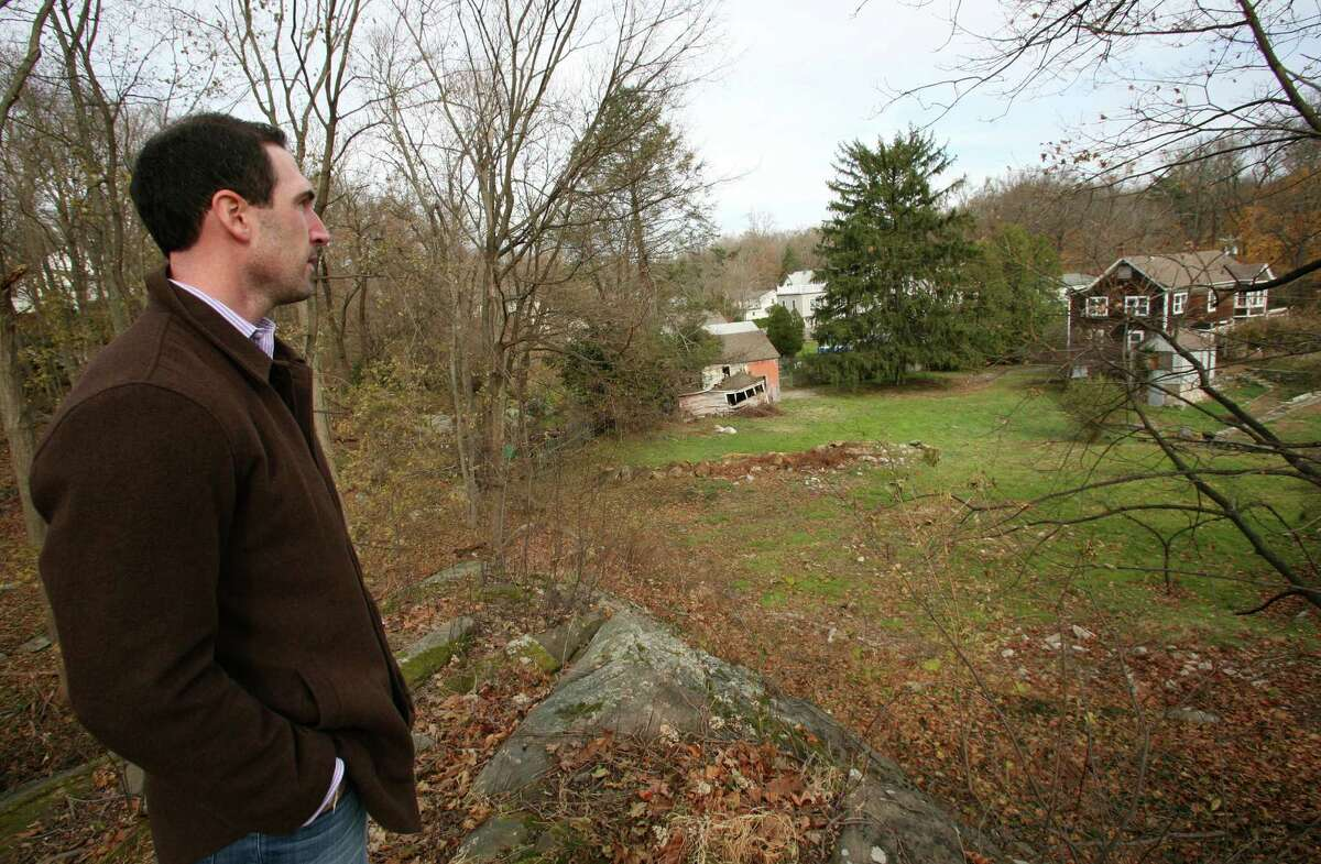 Cos Cob resident Brian Walsh looks out Nov. 16, 2012, over the Orchard Street property purchased by the Greenwich Reform Synagogue, which seeks to builds to build its new home.