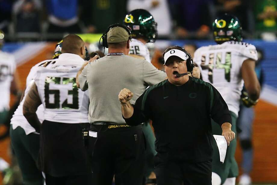 Chip Kelly's teams in his four years at Oregon have been known for their fast-moving, high-powered offenses. Photo: Stephen Dunn, Getty Images