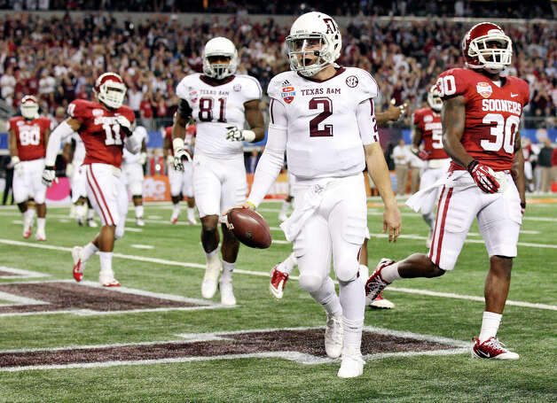 Texas A&M Aggies' Johnny Manziel runs through the end zone after scoring a touchdown against the Oklahoma Sooners during first half action of the 77th AT&T Cotton Bowl Classic held Friday Jan. 4, 2013 at Cowboys Stadium in Arlington, Tx. Photo: Edward A. Ornelas, Express-News / © 2012 San Antonio Express-News