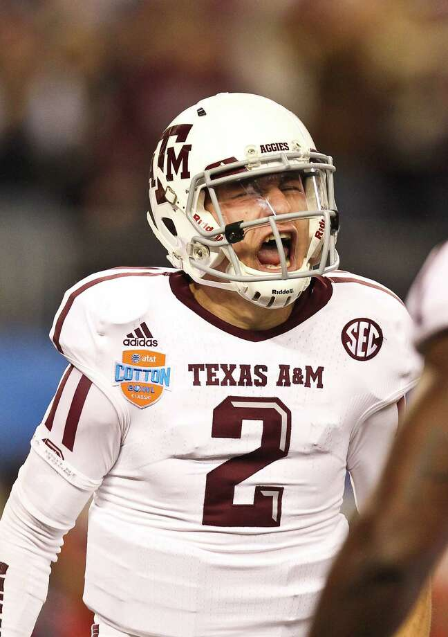Texas A&M quarterback Johnny Manziel (2) celebrates his 23-yard touchdown over the Oklahoma defense during the first quarter of the Cotton Bowl college football game, Friday, Jan. 4, 2013, in Cowboys Stadium in Arlington. Photo: Nick De La Torre, Houston Chronicle / © 2013  Houston Chronicle