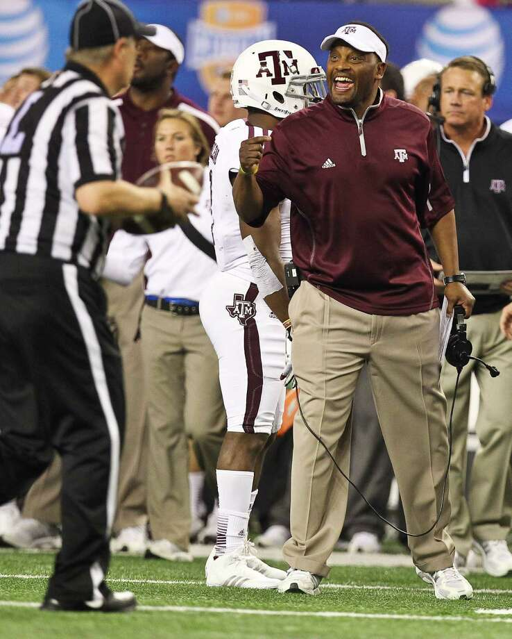 Texas A&M head coach Kevin Sumlin has a few choice words with an official after Oklahoma intercepted a ball during the second quarter of the Cotton Bowl college football game, Friday, Jan. 4, 2013, in Cowboys Stadium in Arlington. Photo: Nick De La Torre, Houston Chronicle / © 2013  Houston Chronicle