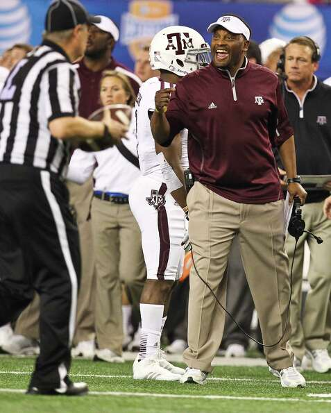 Texas A&M head coach Kevin Sumlin has a few choice words with an official after Oklahoma intercepted