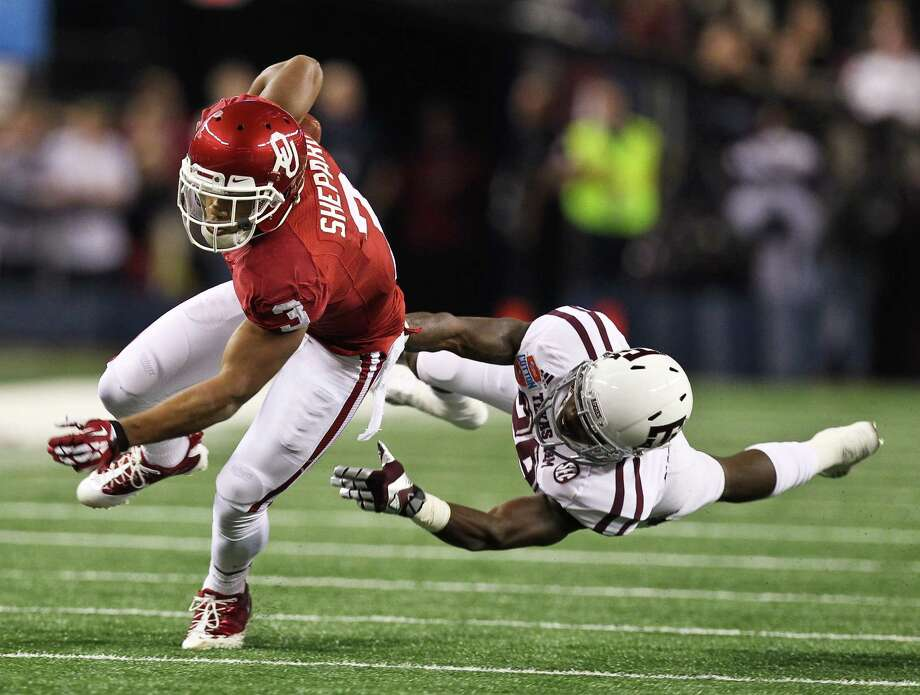 Oklahoma wide receiver Sterling Shepard (3) gets past Texas A&M defensive back Deshazor Everett (29) for a first down during the first quarter of the Cotton Bowl college football game, Friday, Jan. 4, 2013, in Cowboys Stadium in Arlington. Photo: Nick De La Torre, Houston Chronicle / © 2013  Houston Chronicle