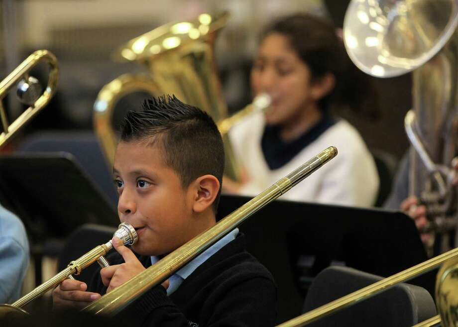 Fifth-grade KIPP student, Daniel Rubio, 10, practices Landrum Middle School students during band class, an example of the charter's blending at the Spring Branch ISD campus. Photo: Karen Warren, Staff / © 2012 Houston Chronicle
