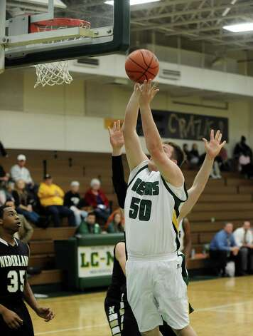 LC-M player Blake Fuss, #50, puts it up for two during the LC-M High School basketball game against Nederland High School at LC-M on Friday, January 4, 2013.  Nederland won over LC-M 66 - 43. Photo taken: Randy Edwards/The Enterprise Photo: Randy Edwards