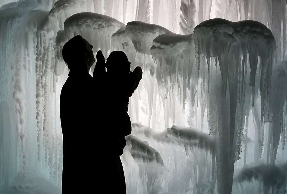 A man and his child explore the Mall of America Ice Castle Friday, Jan. 4, 2013 in Bloomington, Minn. The castle is made of icicles organically grown from four million gallons of water and then fused together. Photo: Jim Mone, Associated Press