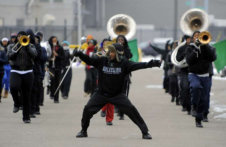 Drum Major Abraham Duffie leads the Cass Tech High School Band, Thursday Jan. 3, 2013, during practice near the school in Detroit. Photo: Steve Perez, Associated Press