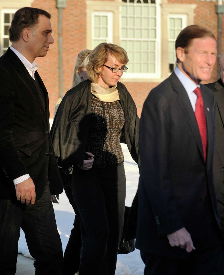 Former Congresswoman Gabrielle Giffords, center, exits Newtown Town Hall at Fairfield Hills Campus after meeting with Newtown First Selectman Pat Llodra and other officials on Friday, Jan. 4, 2013. Photo: Jason Rearick / The News-Times