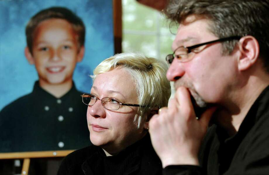 Oxsana and Yuri Naumkin talk about Nicholas, their son who was killed Dec. 22 after a friend shot him accidentally with a handgun, on Saturday, Jan. 1, 2011, at their home in Wilton, N.Y. The Naumkins want changes to the gun permit law so neighbors can find out who has guns in their homes. (Cindy Schultz / Times Union) Photo: Cindy Schultz / 00011603A